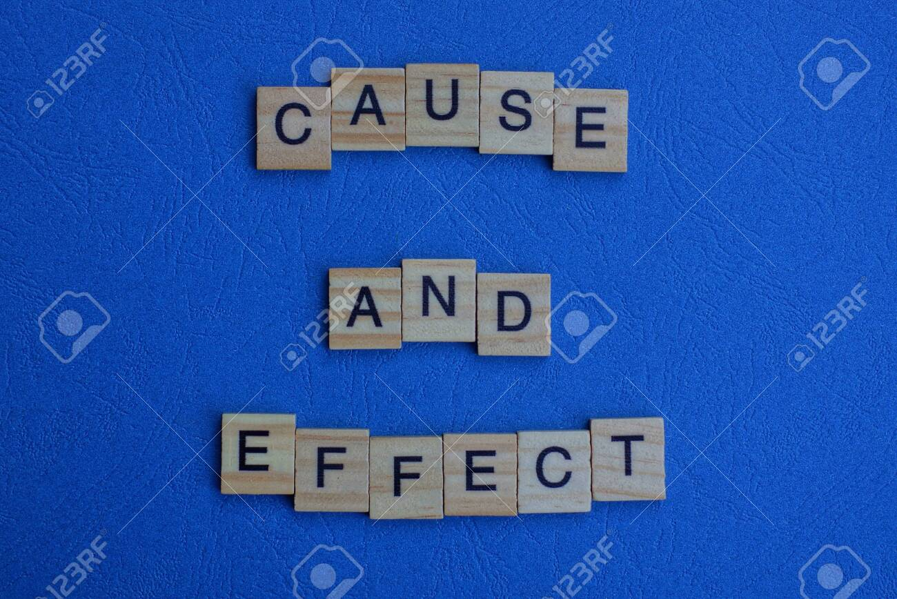 the phrase cause and effect of brown wooden letters lies on a blue table - 134933291