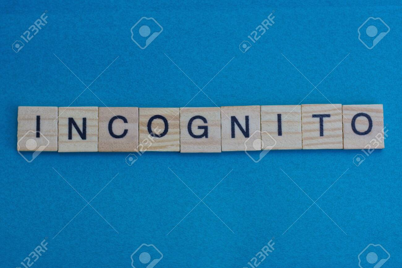 Gray Word Incognito From Small Wooden Letters On A Blue Table Stock Photo Picture And Royalty Free Image Image 137728580