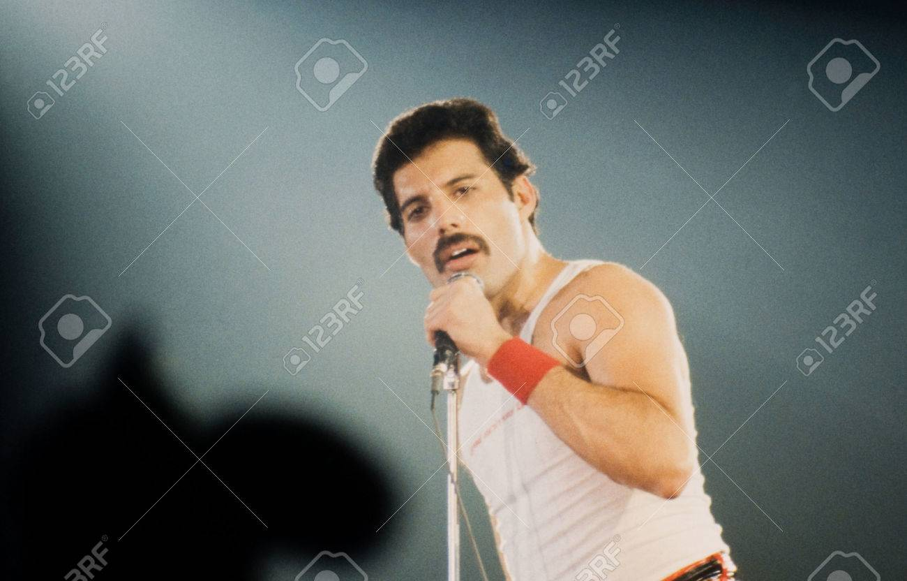 LEIDEN, THE NETHERLANDS - NOV 27, 1980: Freddy Mercury singer of the british band Queen during a concert in the Groenoordhallen in Leiden in the Netherlands - 54917991