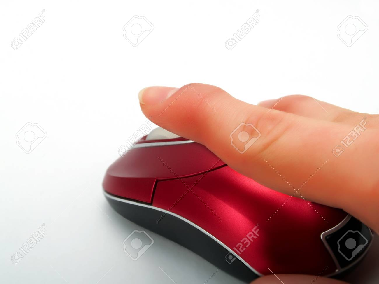 Clicking with a red optical mouse with wireless on pure white background Stock Photo - 2785505