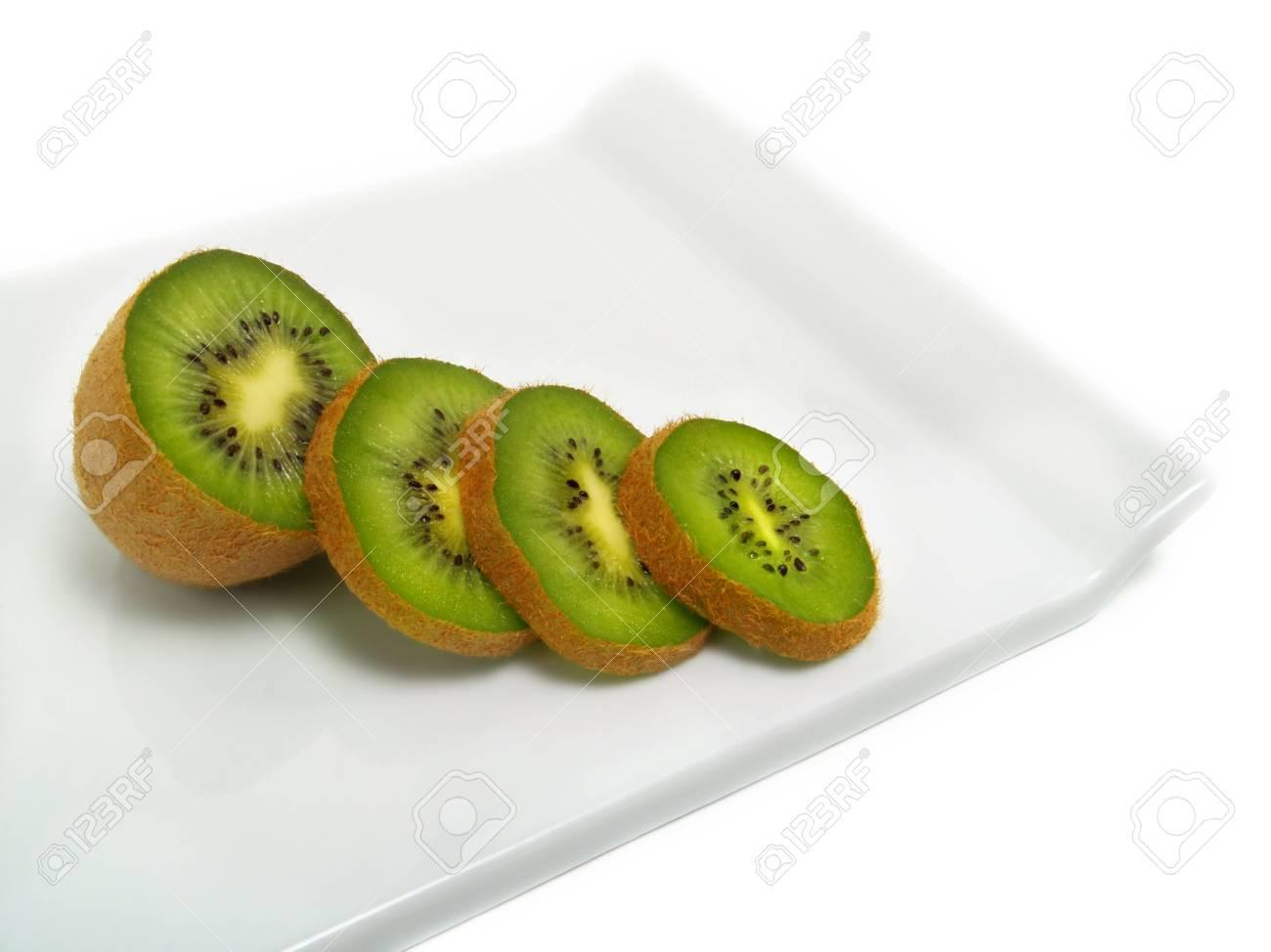 Sliced fresh ripe kiwi on cutting board and isolated on white background Stock Photo - 3251928