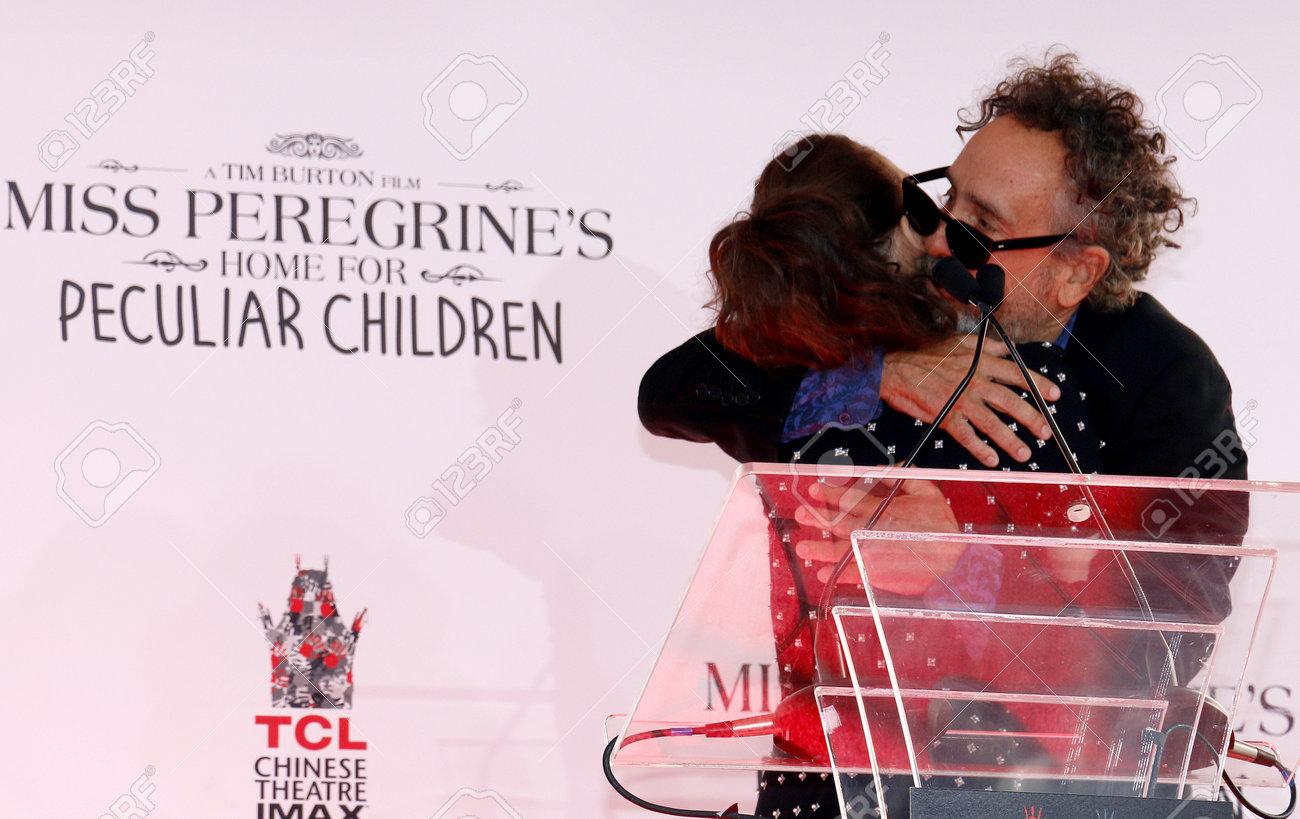 Tim Burton and Winona Ryder at the Tim Burton Hand And Footprint