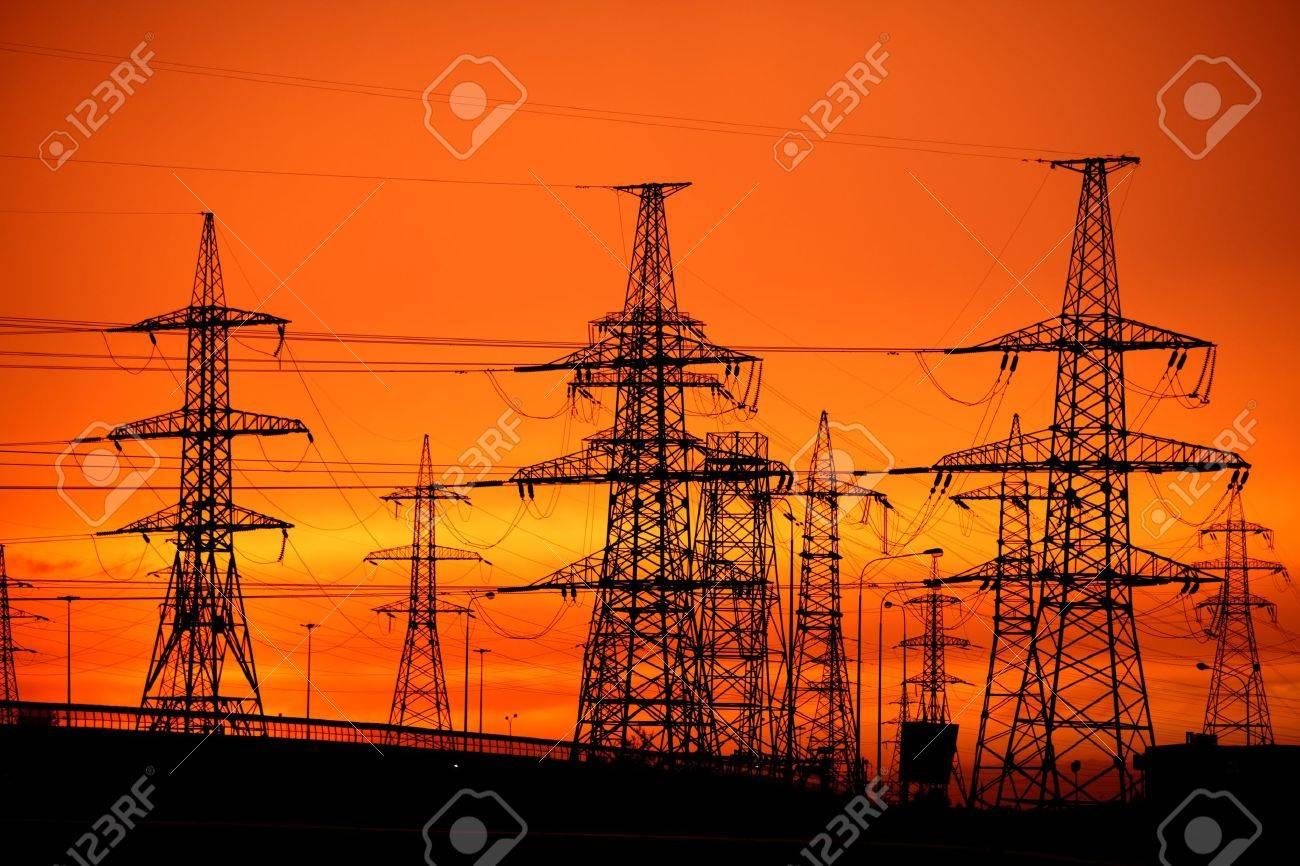 transmission power line on sunset - 16304295