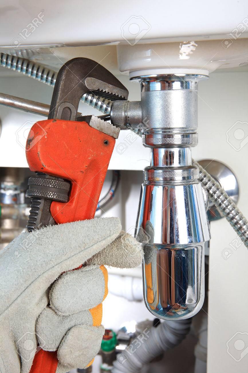 Plumbing Work And Sanitary Engineering Repairing A Pipe Under ...