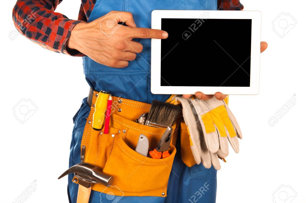 b2c213c8bd99 Banque d images - Homme à tout faire avec un casque et des travailleurs  ceinture pleine d outils isolé sur fond blanc