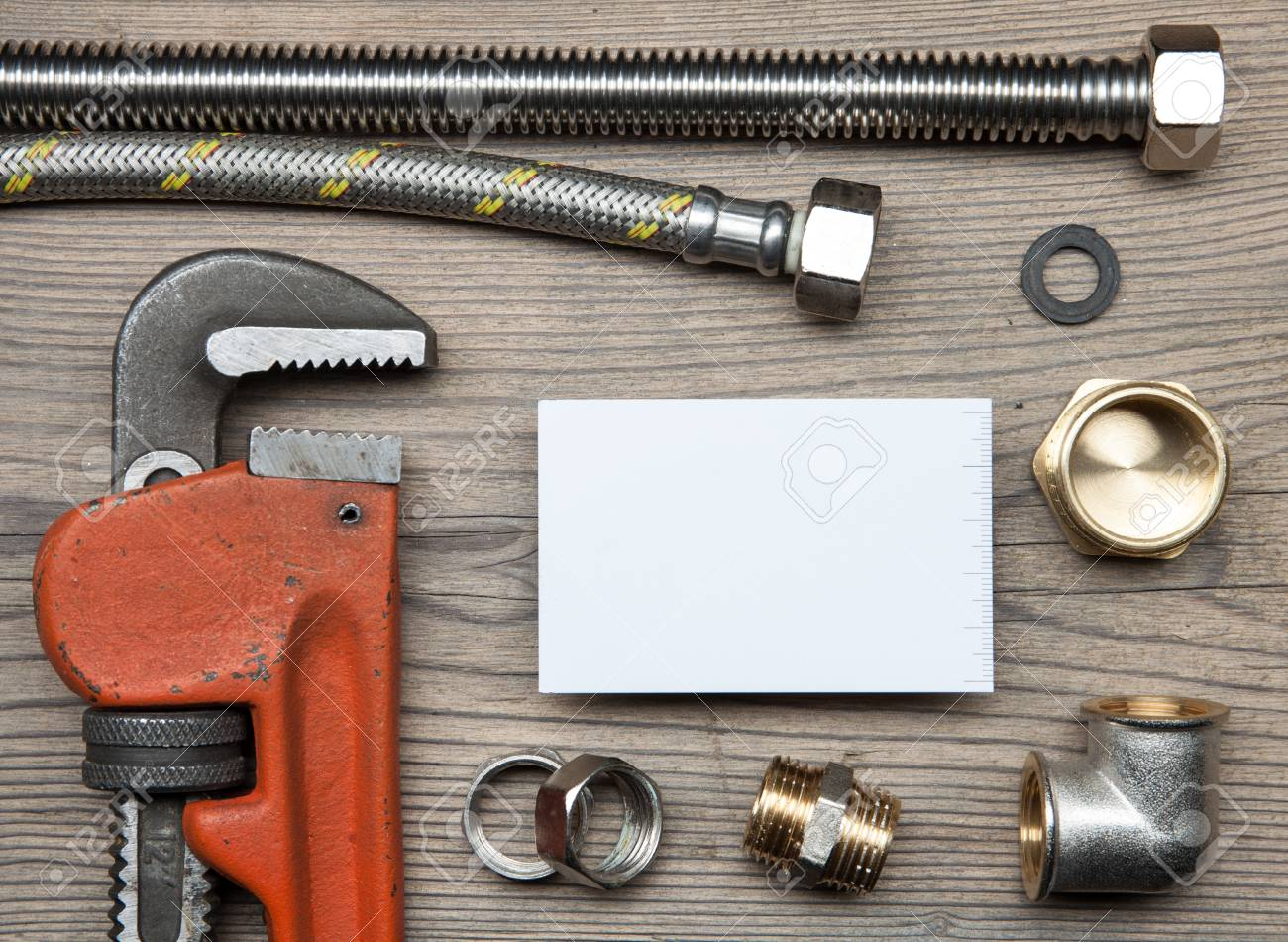 Set Of Pipes Plumbing Tools Fittings And Business Card On The
