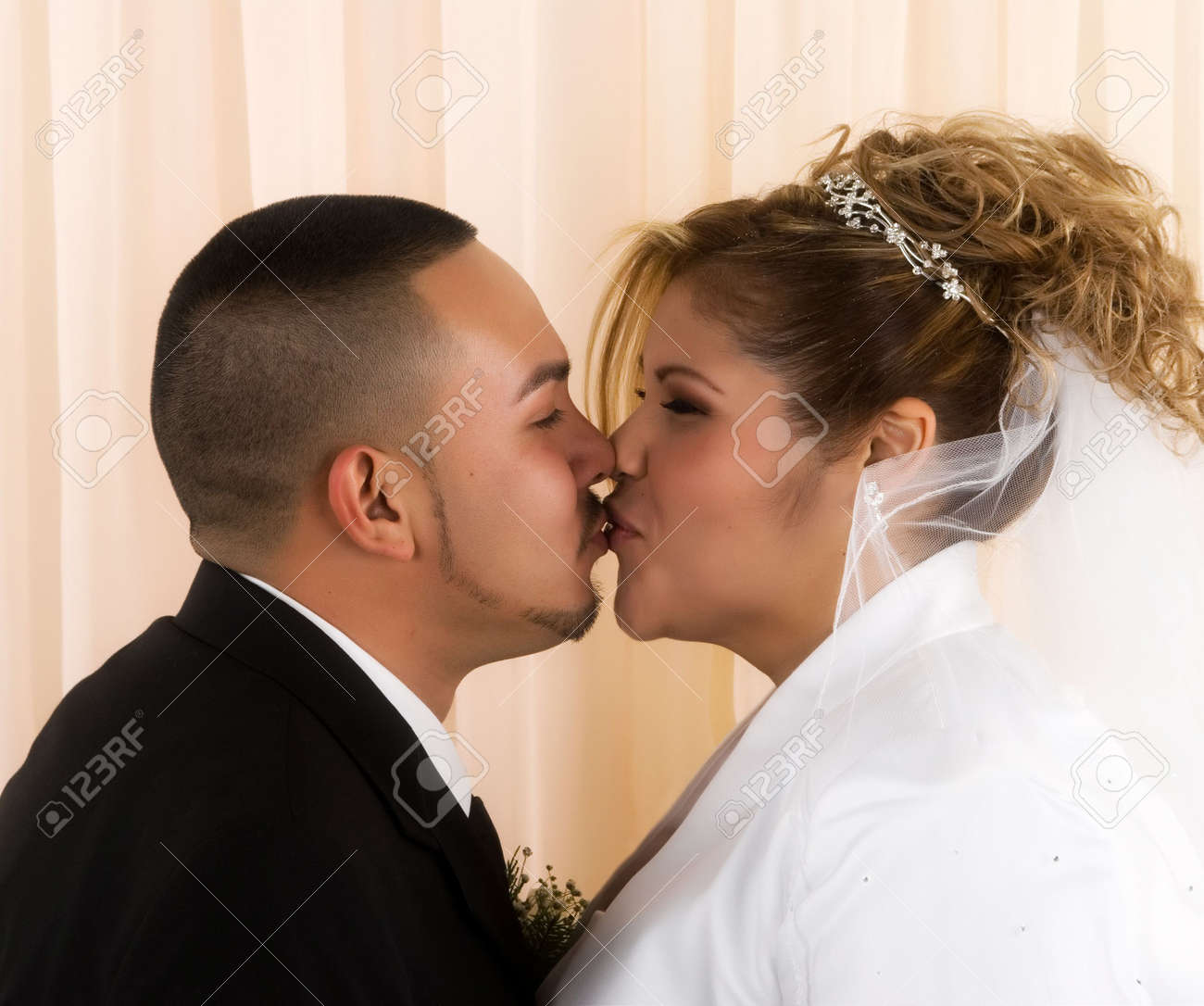 Happy bride and groom kissing Stock Photo - 5611246