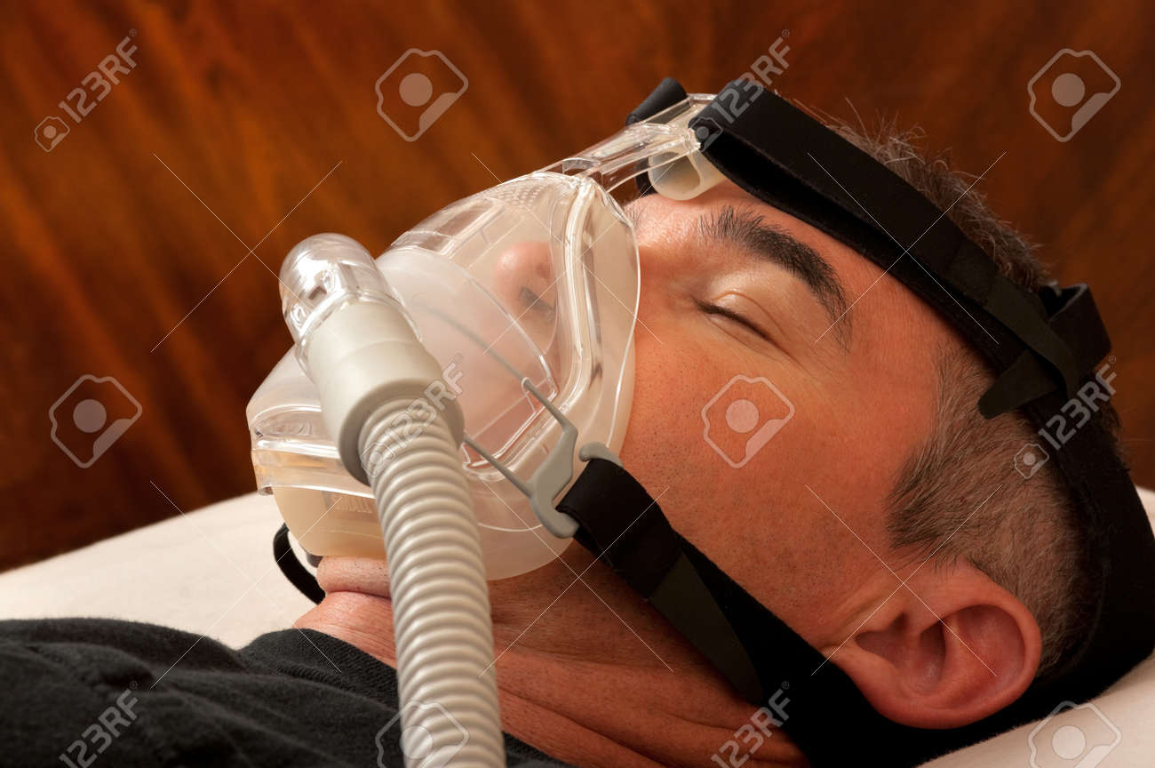Man with sleeping apnea and CPAP machine Stock Photo - 15561703