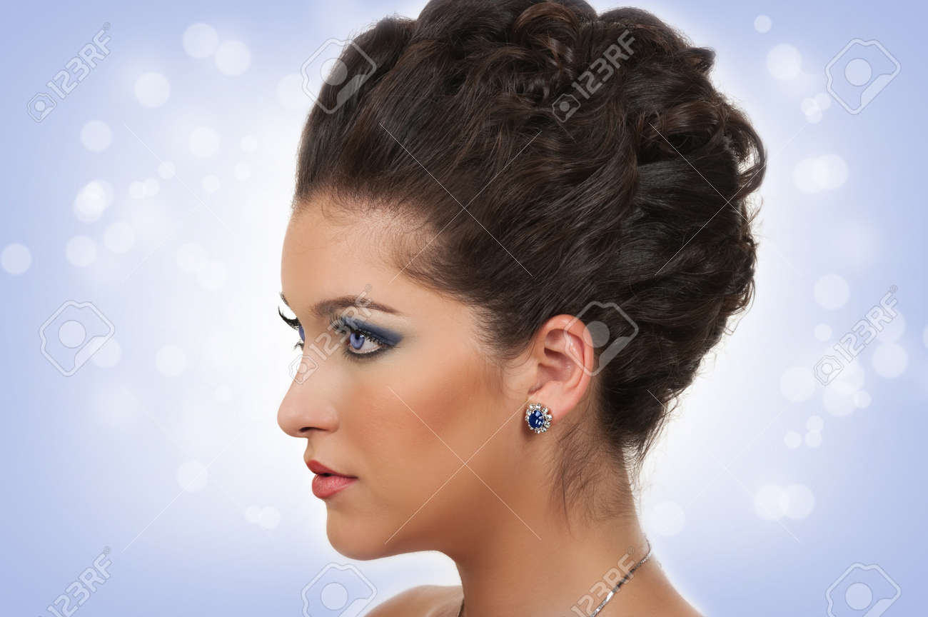 Young woman with beautiful hairstyle, make up and sapphire jewelry Stock Photo - 18284709