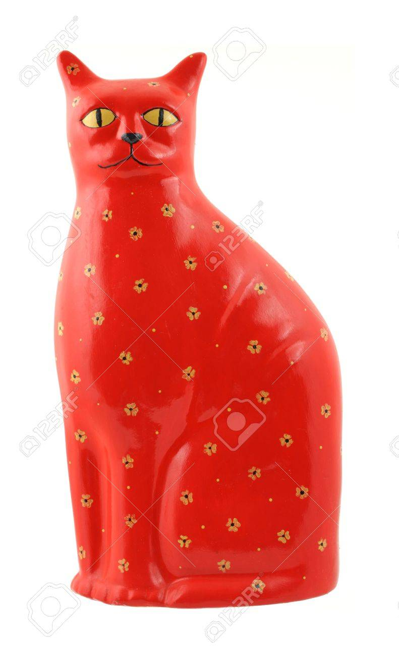 A very brightly colored red ceramic cat with yellow eyes and flowers. Standard-Bild - 5522992
