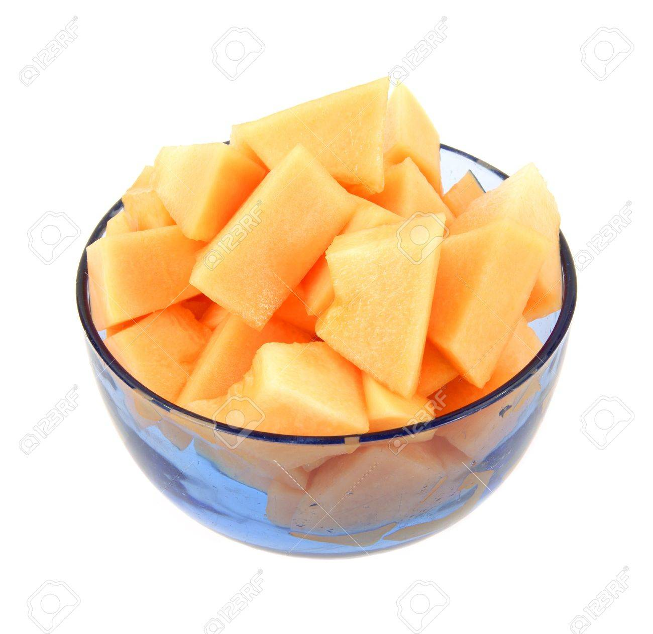 A Sliced Cantaloupe In A Blue Bowl Against A White Background Stock Photo Picture And Royalty Free Image Image 6447847 Learn how to prepare this easy cantaloupe yogurt bowl recipe like a pro. a sliced cantaloupe in a blue bowl against a white background
