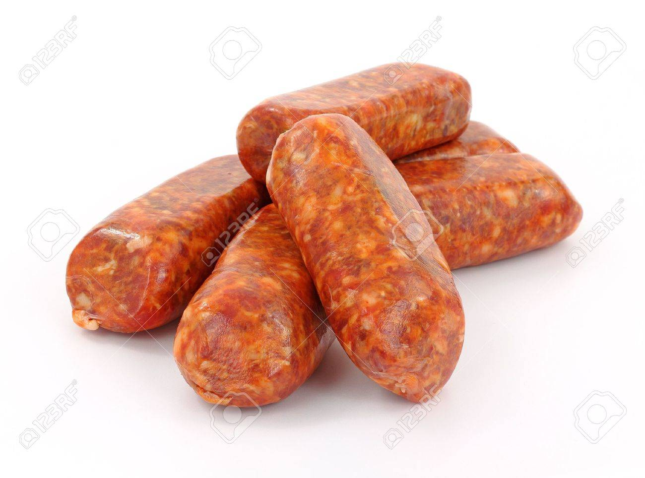 A group of freshly made hot Italian sausage links on a white background. Stock Photo - 9417552