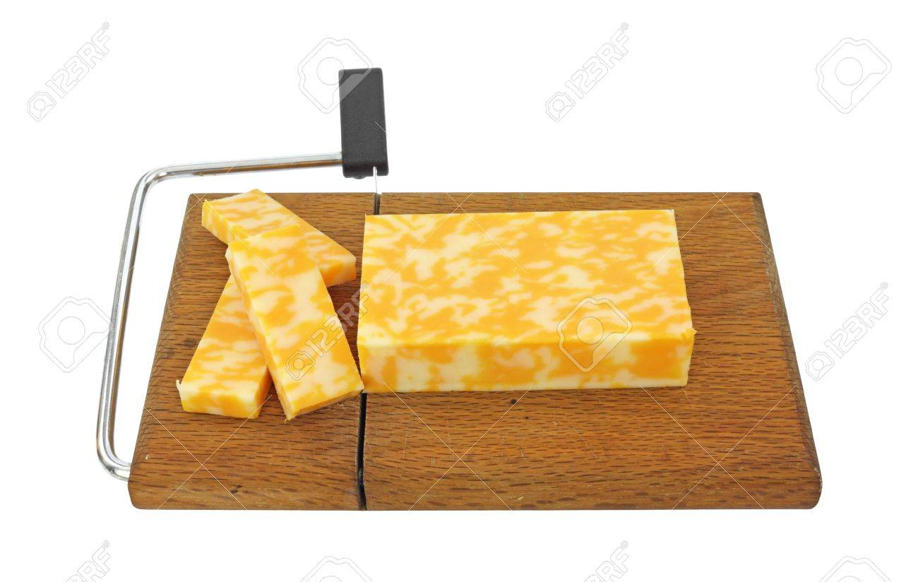 A block of Colby Jack cheese that has been sliced on a cheese cutting board. Stock Photo - 10012055