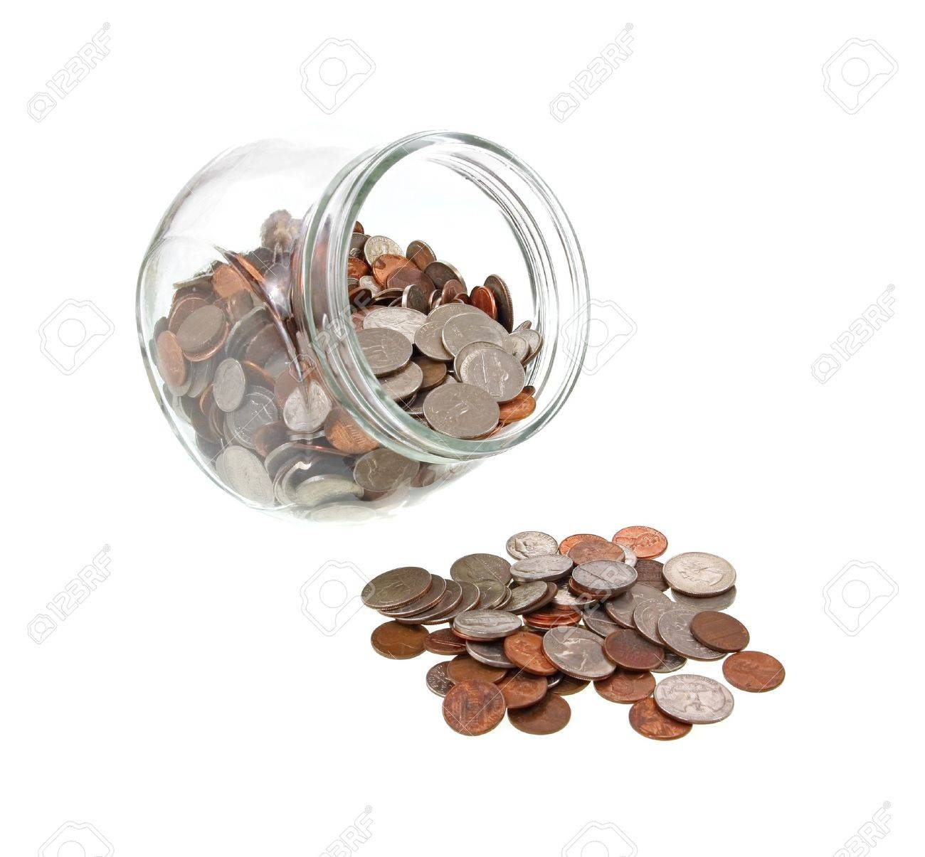 A Wide Mouth Glass Jar With Loose Change And Several Coins In ...