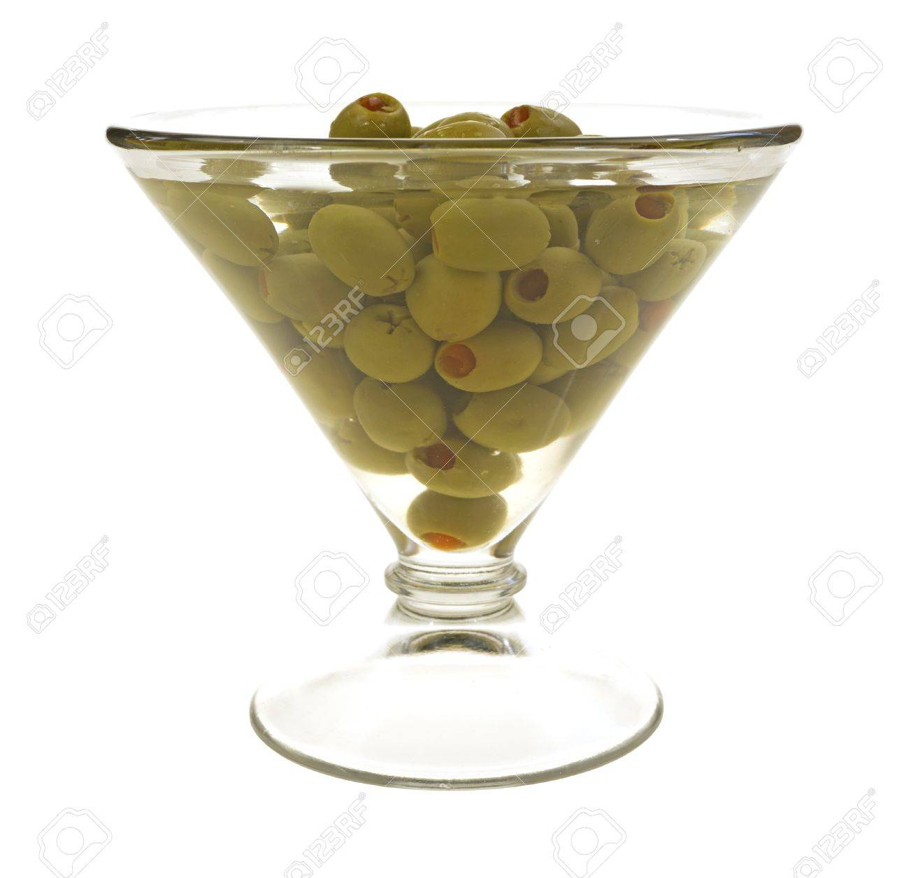An Oversized Martini Glass Filled With Stuffed Olives And Liquid