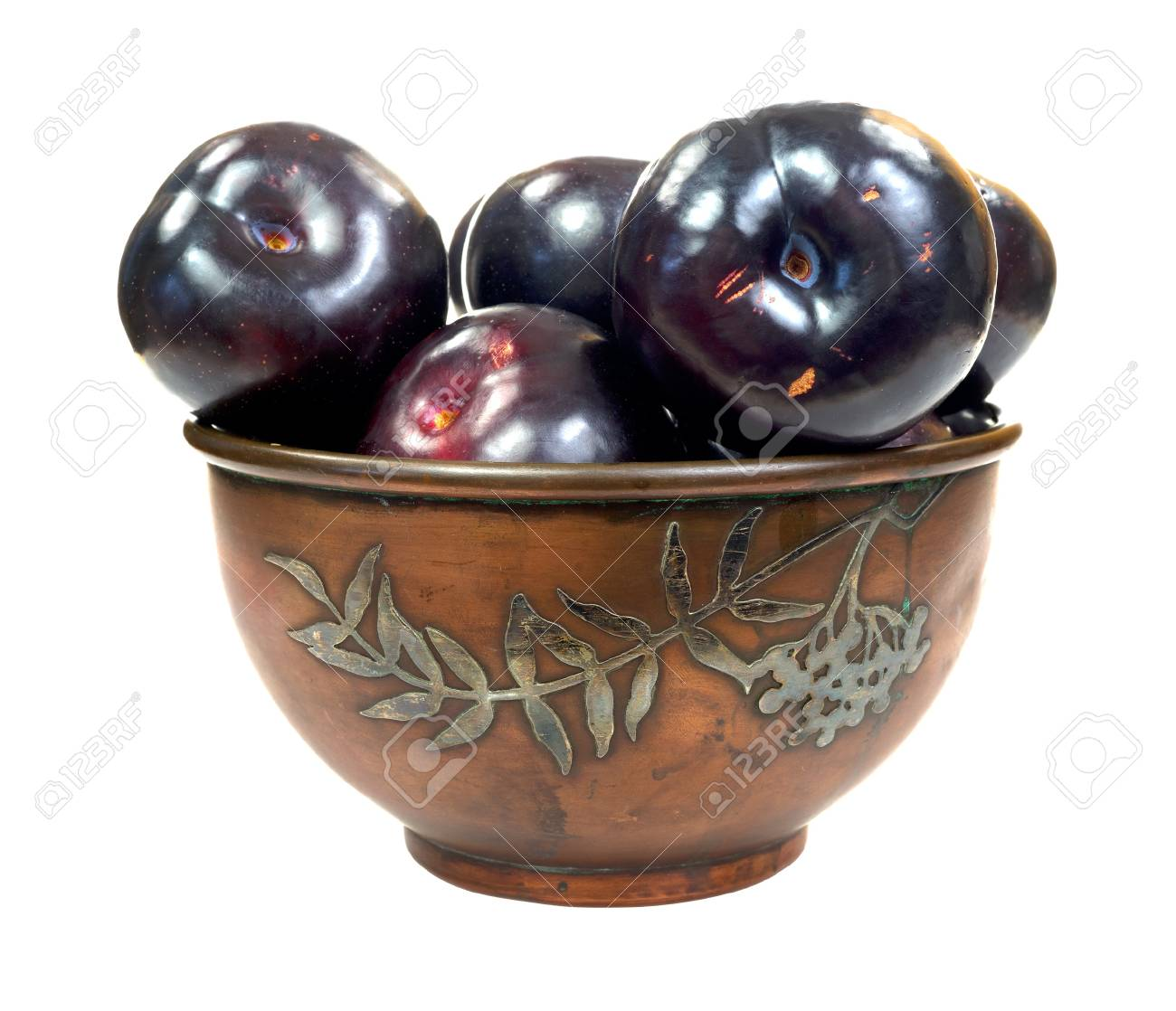 An old copper bowl filled with ripe plums on a white background Stock Photo - 14847875