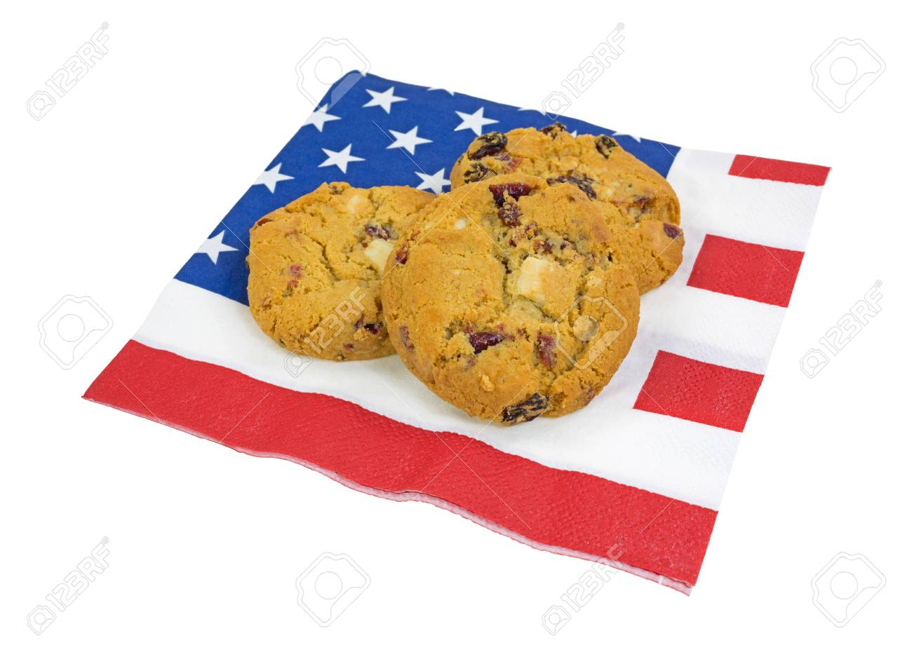 Three white chocolate chip with cranberries on a flag motif napkin. Stock Photo - 21137976