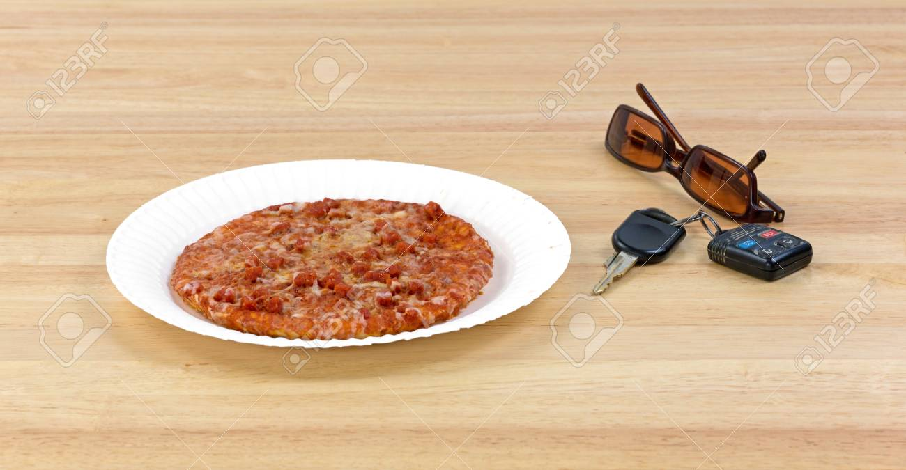 A small pepperoni pizza on a paper plate next to car keys and sunglasses on a & A Small Pepperoni Pizza On A Paper Plate Next To Car Keys And ...