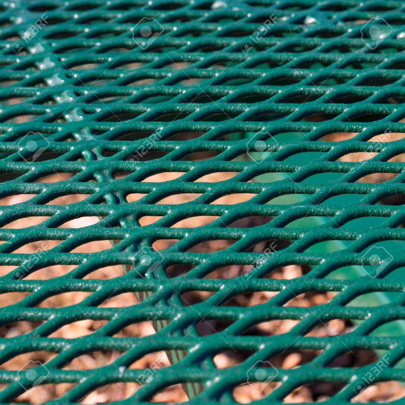 Close View Of A Green Painted Metal Mesh Picnic Table Stock Photo - Mesh picnic table