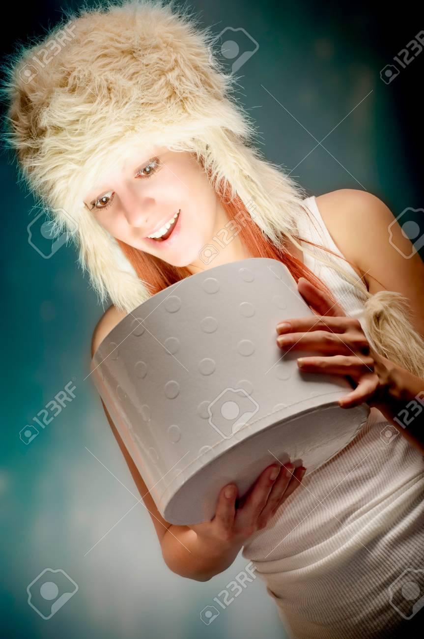 Beautiful woman opening a present Stock Photo - 17366872