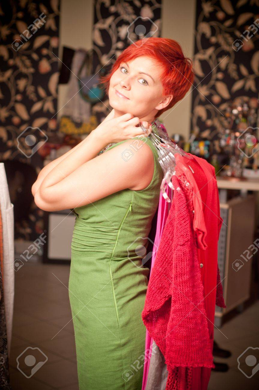 Female sales assistant in clothing store Stock Photo - 17364826
