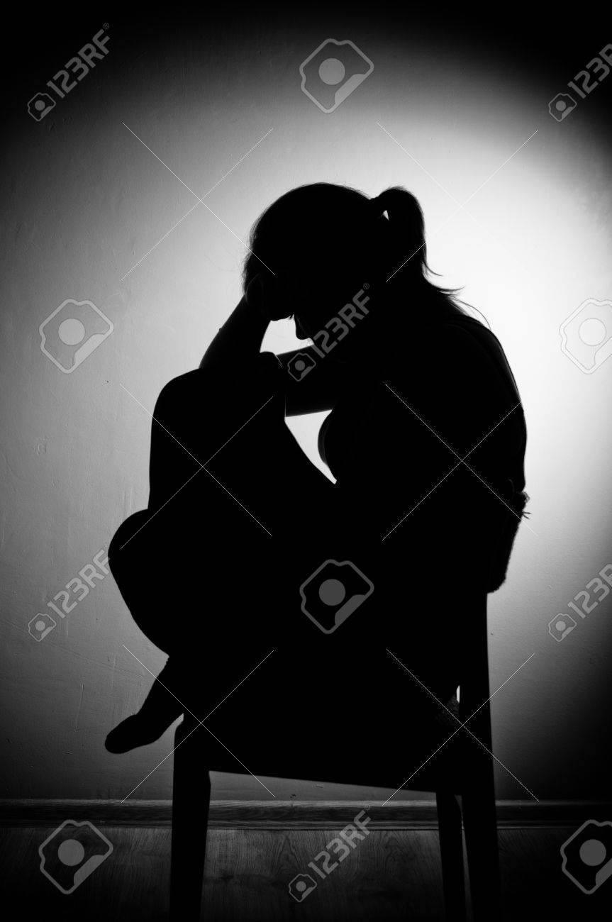 sad woman sitting alone in a empty room - black and white Stock Photo - 17802976