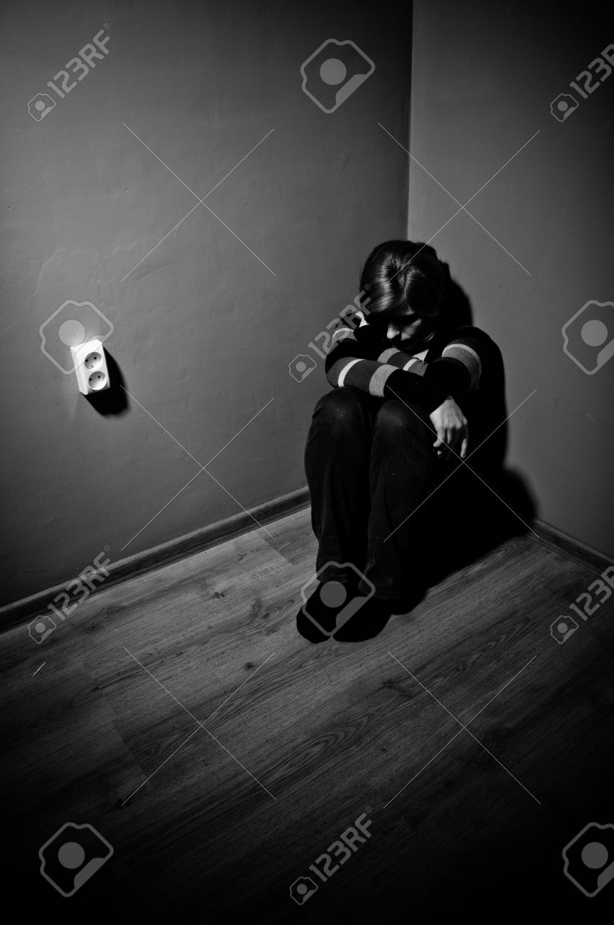 sad woman sitting alone in a empty room - black and white Stock Photo - 17802990