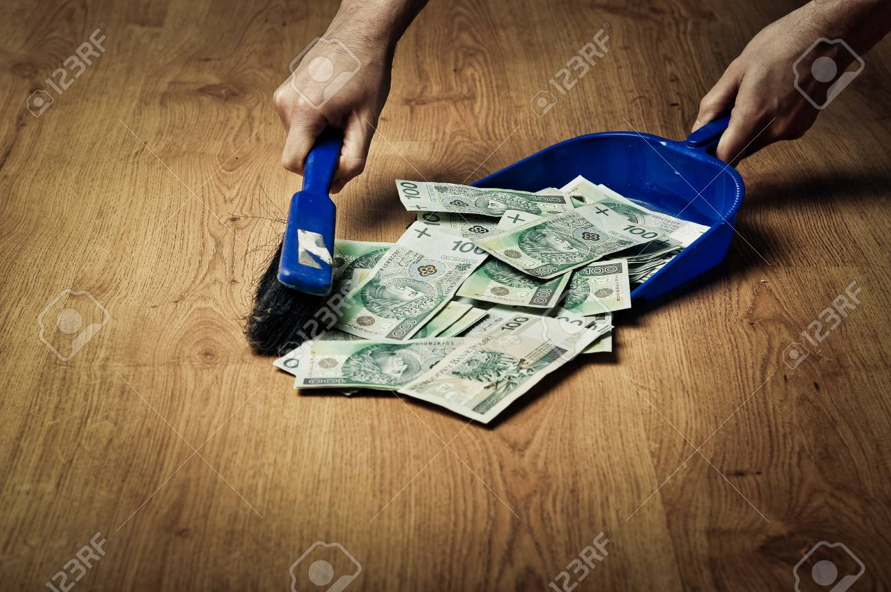 collecting money from the floor stock photo picture and royalty