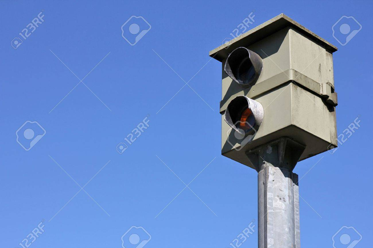stationary speed camera against blue sky - 53317209