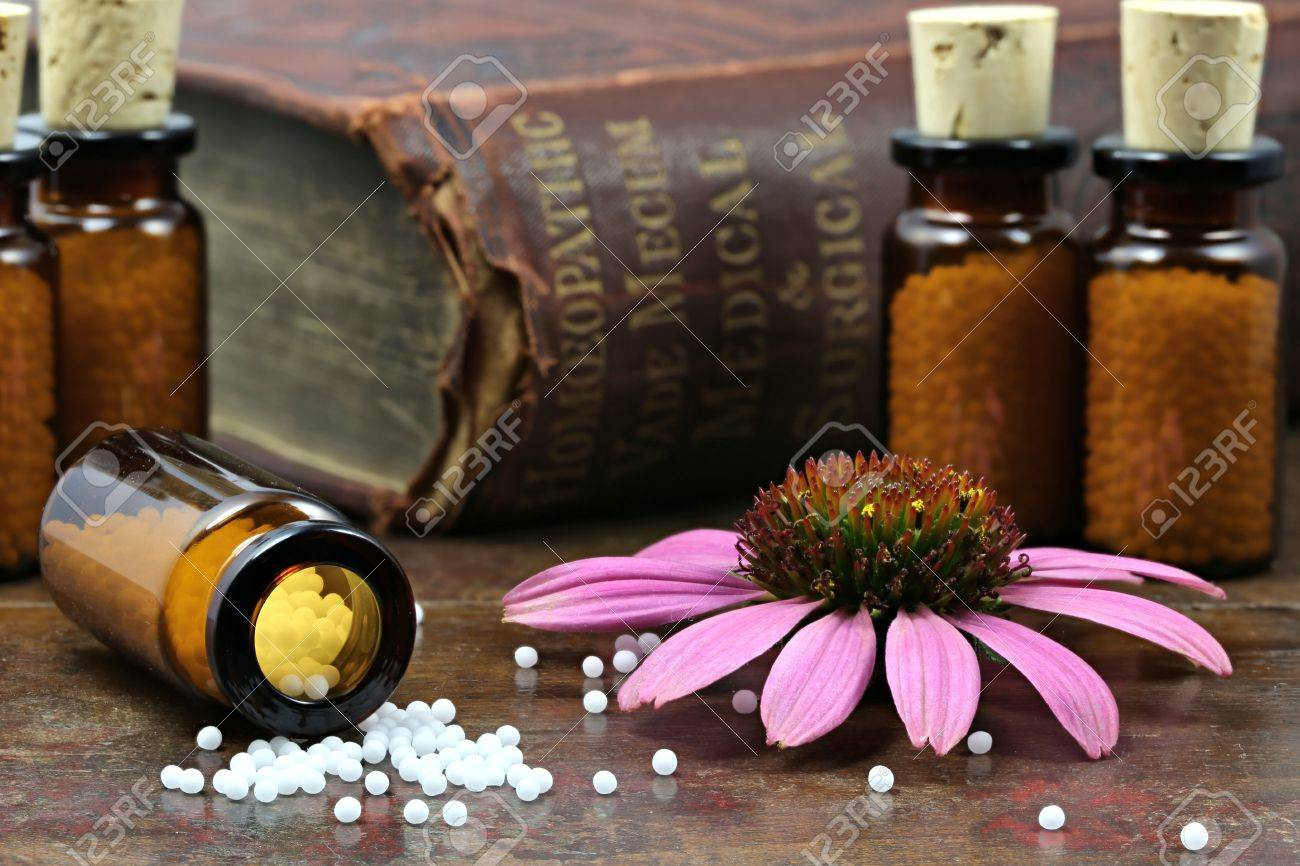 homeopathic echinacea pills on wooden background - 64279074