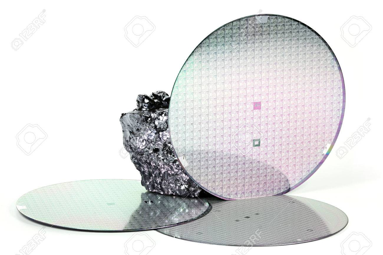wafers with piece of polycrystalline silicon isolated on white background - 65608314
