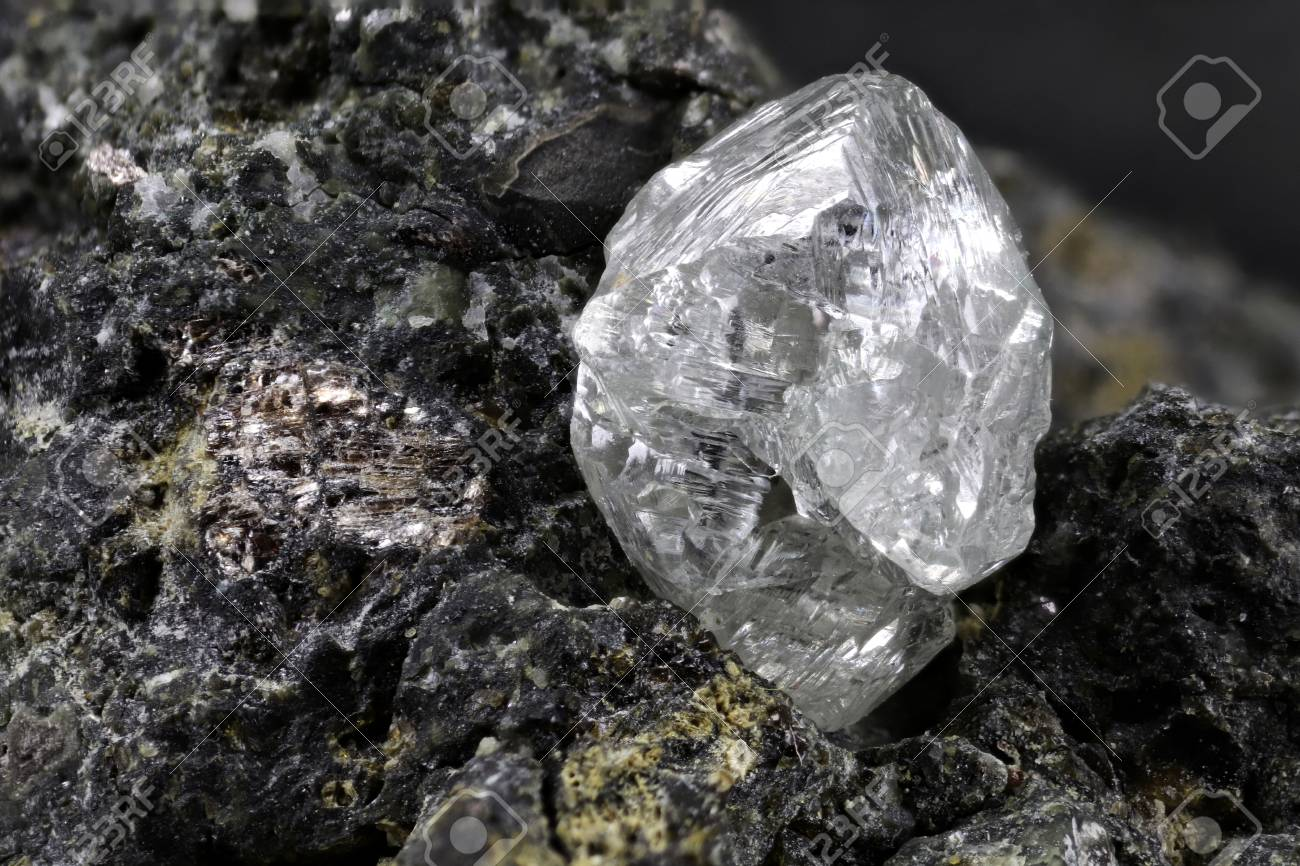 natural diamond nestled in kimberlite - 97920613