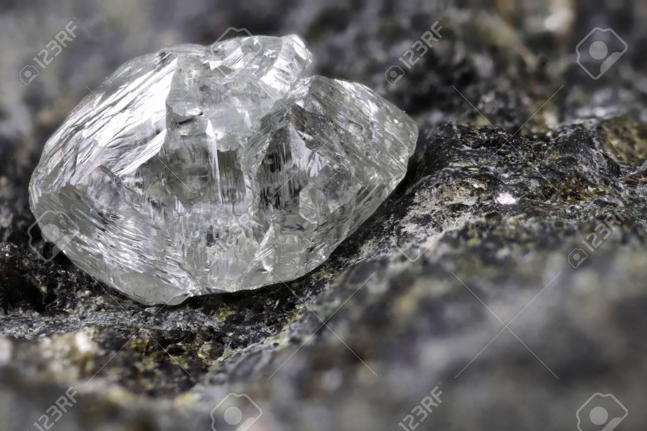 natural diamond nestled in kimberlite - 97825617