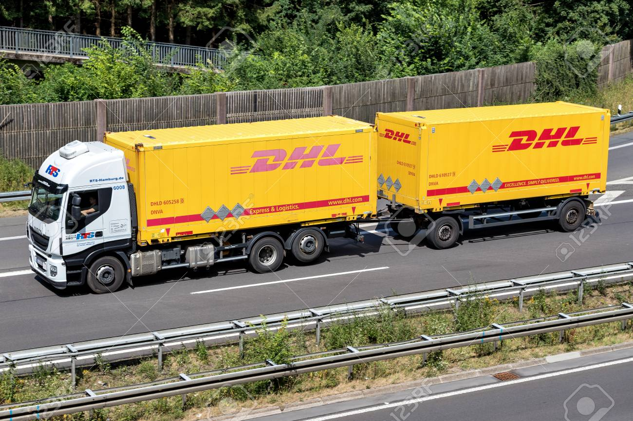 DHL truck on motorway  DHL is a division of the German logistics