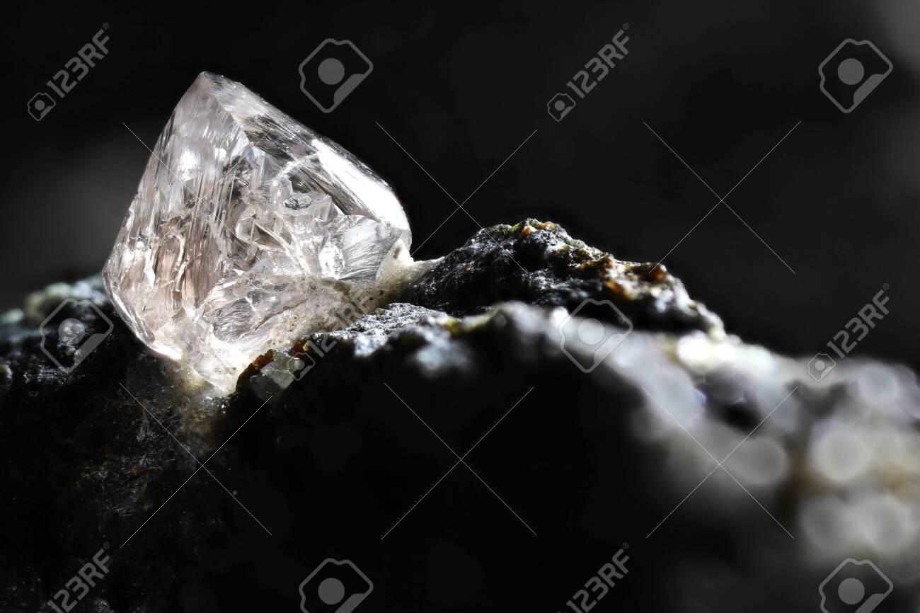 natural diamond nestled in kimberlite - 139303127