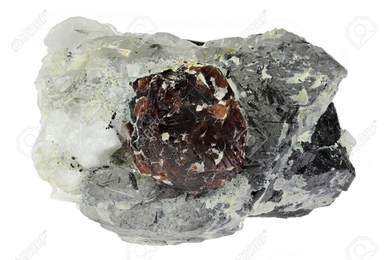 spessartine garnet with quartz, schorl and albite from Skardu, Pakistan isolated on white background - 171055129