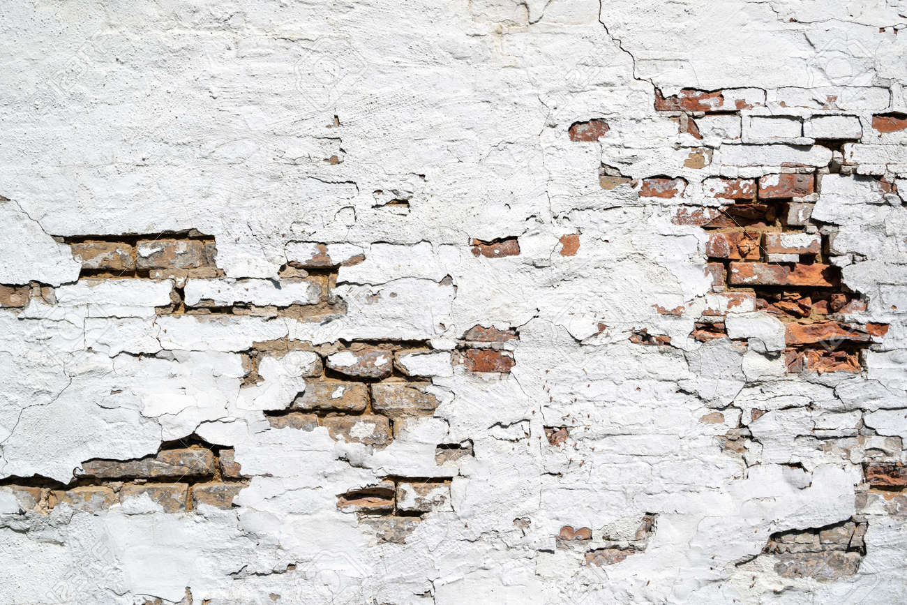 weathered brick wall with crumbling white plaster for background use - 171531098