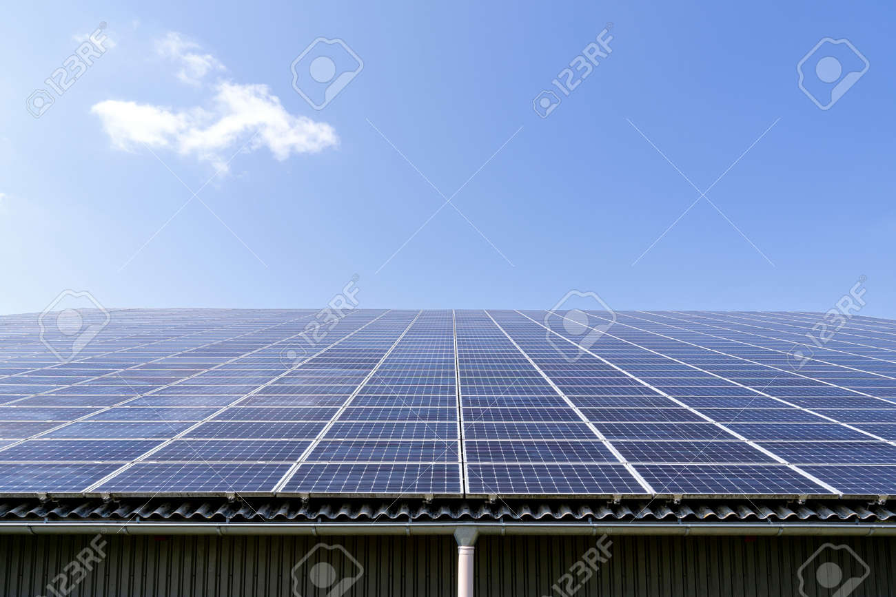 roof-mounted solar collectors on large roof - 171541378