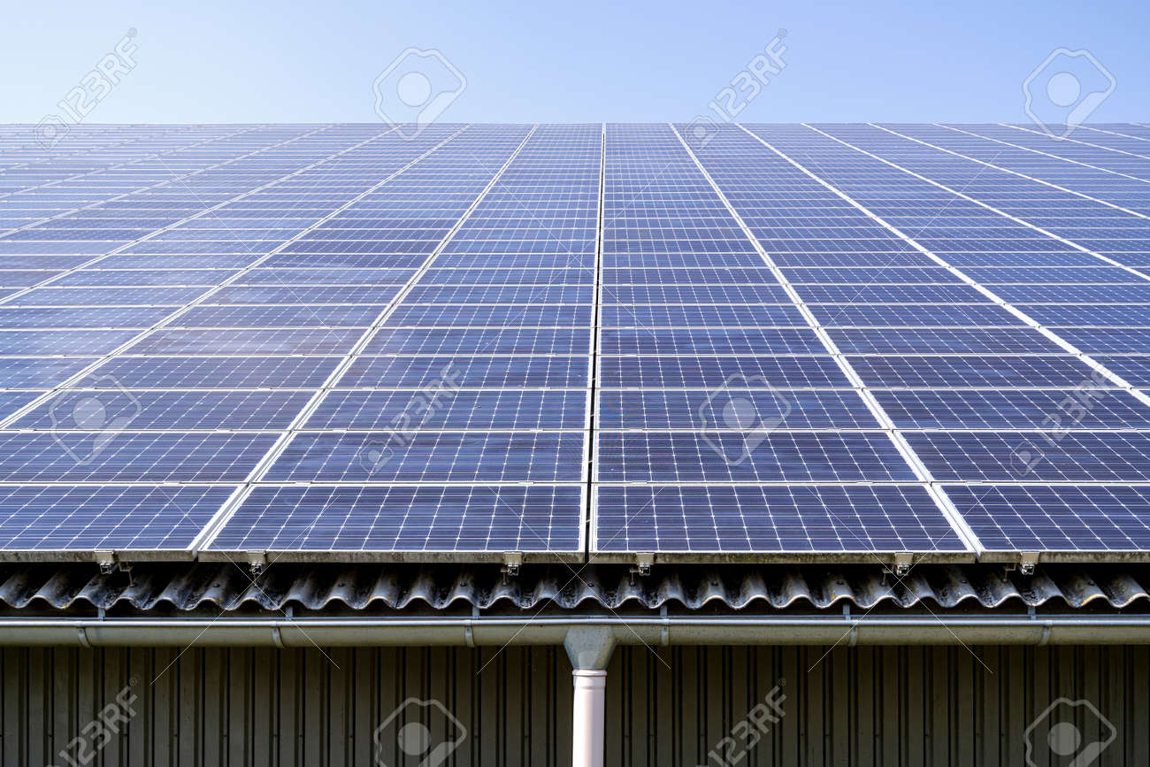 roof-mounted solar collectors on large roof - 171531141