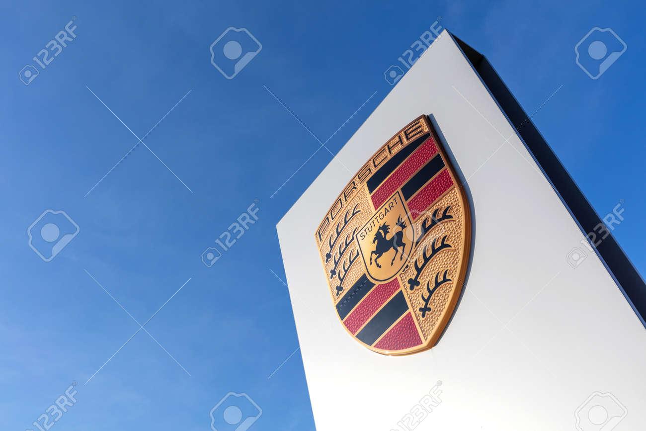 Porsche dealership sign against blue sky - 171646087
