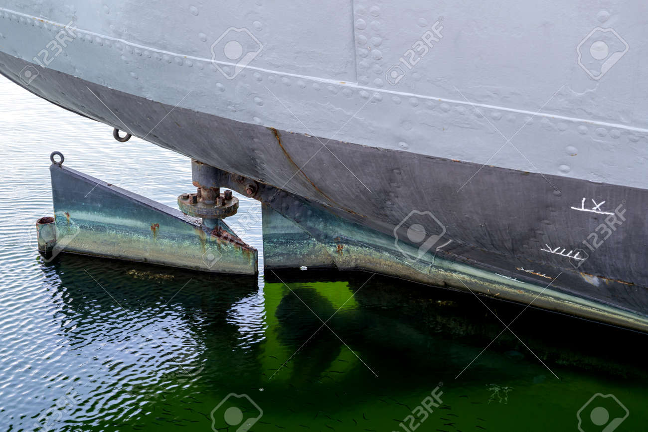 rudder of an old freight ship with reveted hull - 172226425