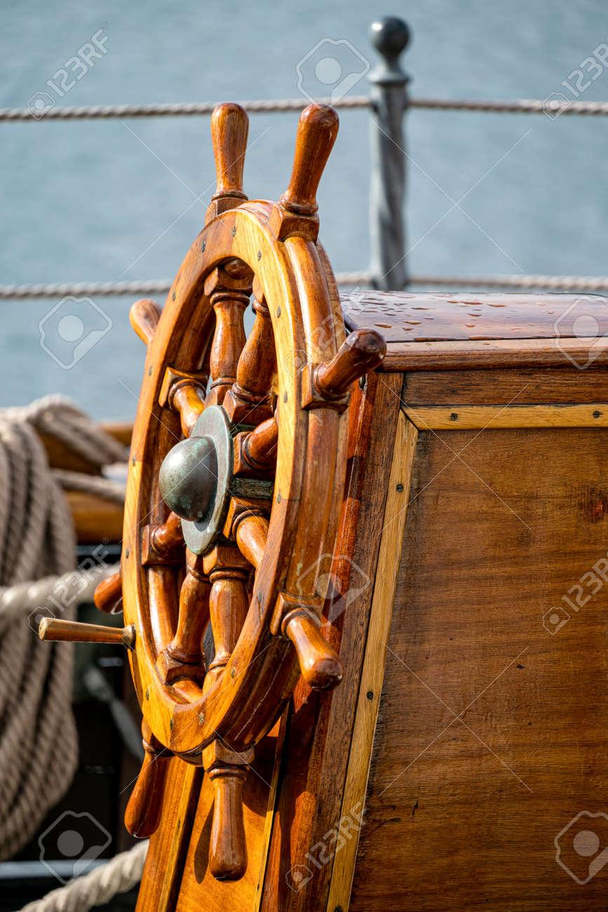 wooden ship's wheel of a tall ship - 172449825