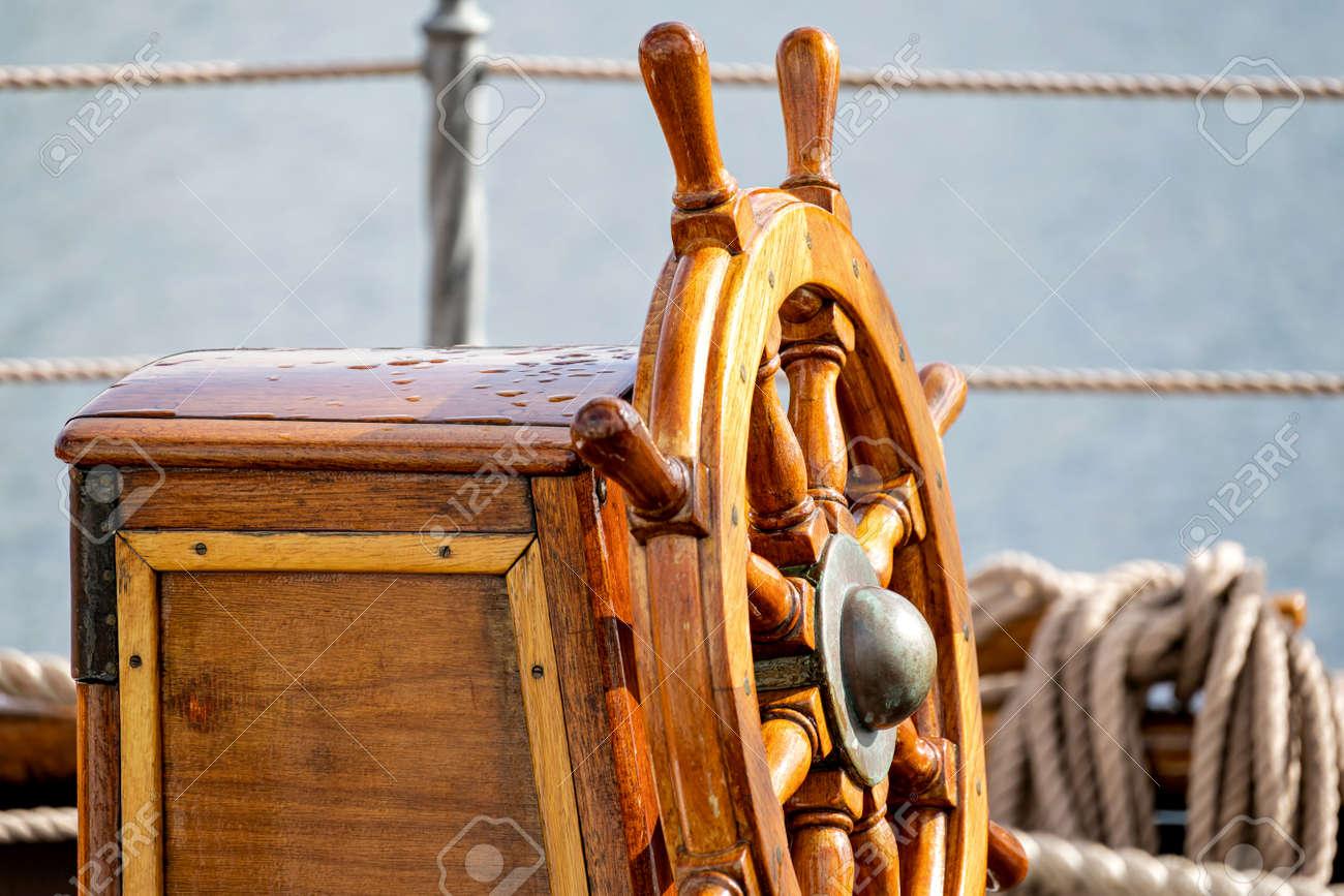wooden ship's wheel of a tall ship - 172235755