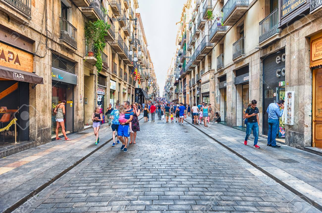 BARCELONA - AUGUST 8: People waking in Carrer de Ferran, scenic street of the Gothic Quarter in Barcelona, Catalonia, Spain, on August 8, 2017 - 88010434