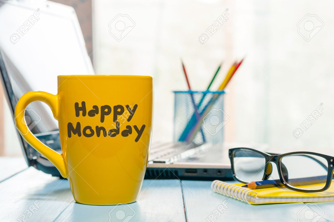 Happy Monday motivational text on yellow morning coffee cup near computer at office workplace. Business background. - 64156236