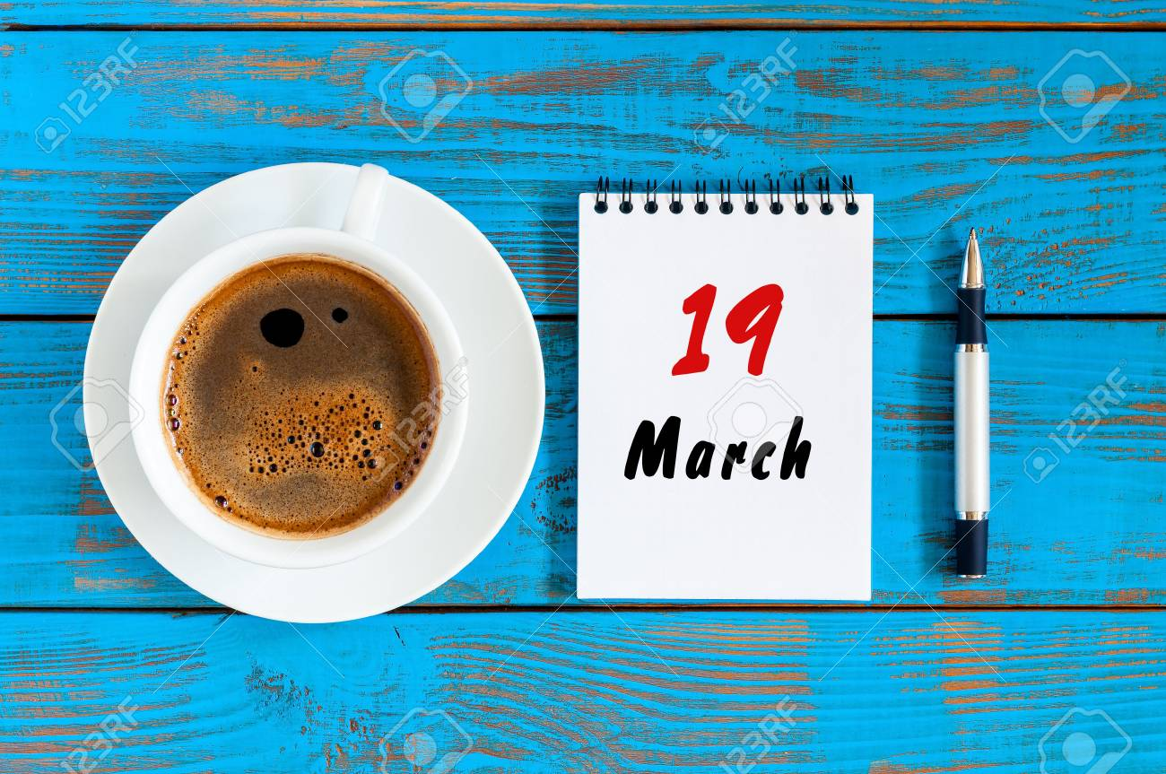 March 19th Day 19 Of Month Calendar On Blue Wooden Table Background With Morning