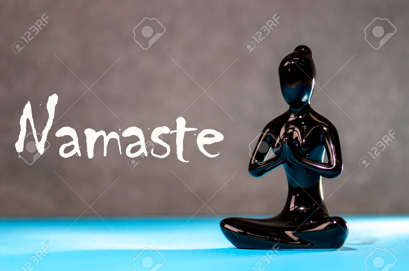Little Black Figurine Woman Keep Hands In Namaste Greeting Stock