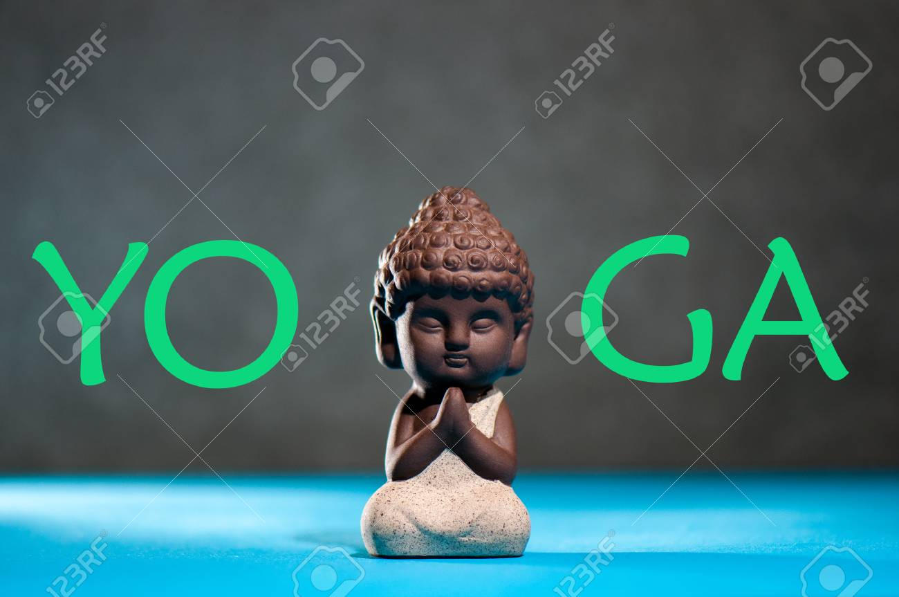 Yoga little buddha with his hand in greeting sign namaste and stock photo yoga little buddha with his hand in greeting sign namaste and yoga studio or class concept m4hsunfo