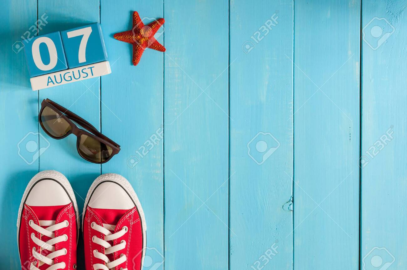 August 7th. Image of august 7 wooden color calendar on blue background. Summer day. Empty space for text - 128338205