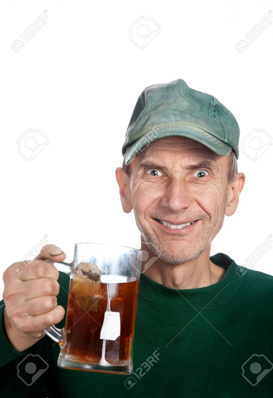 Excitement man in baseball cap holding mug with tea at white background Stock Photo - 9231893